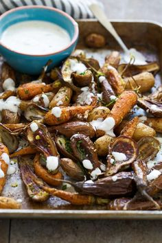 Roasted baby carrots, fingerling potatoes and baby eggplant with garlicky lemon Greek yogurt.