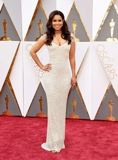 Tracey Edmonds | Oscars 2016   The Extra host glowed in a pearl-encrusted Lorena Sarbu design that featured off-the-shoulder flutter sleeves. Diamond earrings and rings brought added sparkle to the ensemble.
