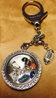 Officially Licensed College football charms, and our new key chains.  Www.talisaandashtyn.origamiowl.com #Gators #keychain #football