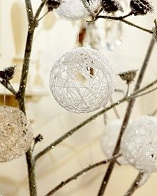 With little more than some balloons yarn and glitter, you can fill your home with decorative snowballs.
