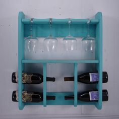 Wine Rack with Wine Glass Holder - Wall Hanging - Rustic Lt. Turquoise - other colors available. $79.95, via Etsy.
