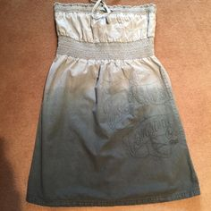 Adorable Strapless Tie Dye detailed Fox Dress Cute summer dress!  By Fox Racing.  Strapless with empire waist and Fox Racing Company embroidered on right side.  Various green tie dye colors.  Perfect easy go to dress.  Adorable with wedges or flats!  Small discoloration on back from the tie dye I think.  See pic.  Hard to see. Fox Dresses Mini
