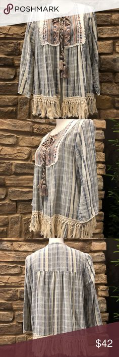 Knox Rose embroidered open front cardigan size L New without tags Knox Rose embroidered cardigan jacket. Off white and blue stripe. Embroidered detail around collar. Three quarter sleeve. Accent tassel hemline. Open front with rope tie at collar. Stunning detail material. Boho chic. Lightweight, stylish cardigan is an easy transition from day to evening. Perfect for all seasons. Will be your to-go-to cardigan blazer. Knox Rose Jackets & Coats Blazers
