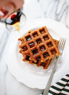 Simple gluten-free spiced pumpkin waffles that are crisp, fluffy and delicious! cookieandkate.com