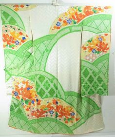This is a Kimono silk fabric cut into Furisode shape and stitched roughly before sewing to make Furisode.  It has 'botan'(peony) and classical design, which is dyed.  It also has a design of bamboo fence, which is dyed with Shibori (tie-dye) technique
