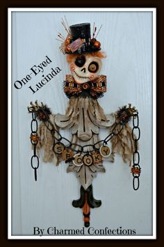 "Halloween Artwork from LeeAnn Kress of Charmed Confections.  This is One-Eyed Lucinda.  She is a 21"" tall greeter made to hang on the wall.  This piece is sold, but look for more of these types of pieces at Halloween and Vine!!"
