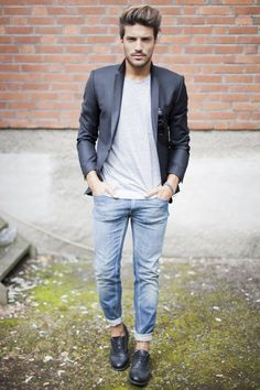 Wear a dark blue blazer with baby blue jeans if you're going for a neat, stylish look. This outfit is complemented perfectly with black leather brogues.  Shop this look for $126:  http://lookastic.com/men/looks/jeans-sunglasses-crew-neck-t-shirt-blazer-brogues/5611  — Light Blue Jeans  — Black Sunglasses  — Grey Crew-neck T-shirt  — Navy Blazer  — Black Leather Brogues