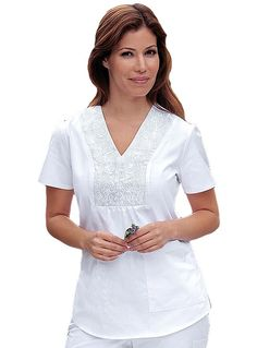 Look stylish with this embroidered scrub top from Barco Prima. This v-neck top features an embroidered detailing plus shirring on the neckline. Nurse Scrubs, Medical Scrubs, Funky Fashion, Office Fashion, White Scrubs, Uniform Design, Diy Couture, Scrub Tops, Sewing Clothes