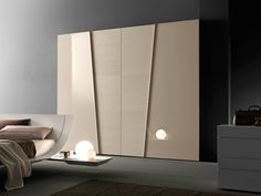Sectional lacquered wardrobe with sliding doors DIAGONAL by Presotto Industrie…