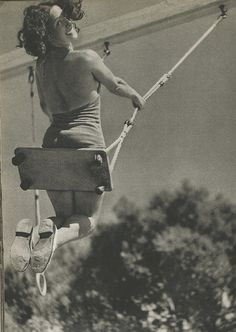 1940, Betty as a young teen swinging on my swing that grandpa made for me.