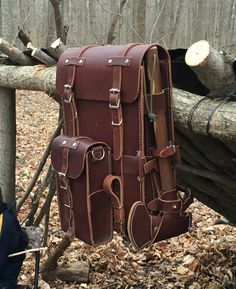 Leather bushcraft day pack with detachable belt system for pouches and camp axe holder. All hand sewn in 9-10oz Latigo (front and back) and 6-7oz Latigo (sides and front pouch). All stainless steel hardware.   By Gillie Leather