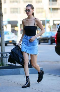 Bella Hadid took on the heat in a strapped body suit, a denim skirt and military boots
