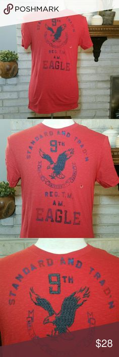NEW American Eagle Graphic Tee T Shirt Red Logo M This is for a Brand new, with tags, 100% authentic men's American Eagle graphic T shirt. It is short sleeve, 100% cotton, size medium, and brand new. It has an embroidered / faded stamp logo. Athletic fit, tagless shirt. Smoke free home! Mix and match with newly listed NEW American Eagle, NEW Hollister, and NEW Abercrombie & Fitch to get a bundle discount! See size chart pic listed. American Eagle Outfitters Shirts Tees - Short Sleeve