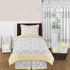 The Sweet Jojo Designs 4-piece Avery twin bedding collection will create a stunning boutique setting for your child. Displaying a lovely damask pattern, this set features a gorgeous gray, yellow and white finish.