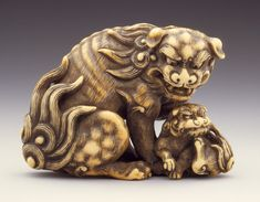 Chinese Lion and Young (親子獅子), ivory with staining, sumi, and inlay, by Tomotada (active before 1781). LACMA
