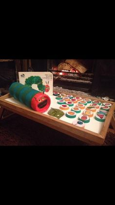 What an amazing idea this is. The caterpillar is Pringles packet and the pics of food are on milk bottle tops. Great way to do some interactive reading with a child.