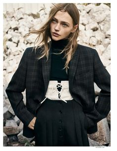 Sasha pivovarova wears a masculine and feminine look strikes the perfect balance with a plaid jacket and corset detail for Vogue Magazine Paris November 2016 issue