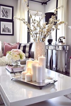 This mother pearl vase from HomeGoods looks great mixed in with all these neutral colors. I love the hint of shimmer it gives off as well (Sponsored pin) Coffee Table Styling, Cool Coffee Tables, Decorating Coffee Tables, Coffee Table Candle Decor, Home Living Room, Living Room Decor, Apartment Living, Coffee Table Decor Living Room, Deco Table