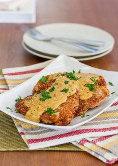 Almond Crusted Pork Chops with Mustard Sauce - delicious pork chops drowning in a mustard creamy sauce. South Beach diet friendly.