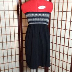 Old Navy Swimsuit Coverup Black swimsuit coverup is 100% cotton. Top has black, white & grey smocking. Cute & comfortable. In excellent condition, no rips, tears, pulls or stains. Old Navy Swim Coverups