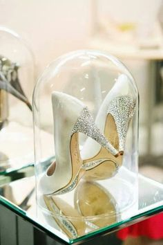 love the idea to keep wedding day shoes in glass case like Cinderella