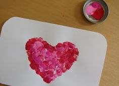 fingerprint valentines  (made with a heart stencil).  Note the clever way of presenting a tiny bit of paint.