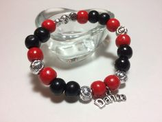 Wear the pride in your favorite gymnast on your wrist with a customized Player Pride Bracelet!  Each beautiful, customized bracelet has a dance charm surrounded by beads in your team's colors and & silver lantern beads!