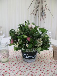 Buckets are an economical and neat choice, as they don't take up too much room on the table. These blackboard pots allow to write your table names on too.