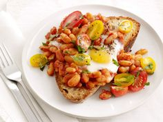 For a protein-packed meal, top slices of crusty bread with navy beans, a tomato salad and a fried egg.