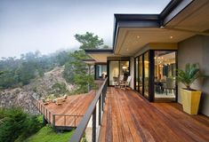 Crafting a multi-level hardwood deck over the terrace has become a trend all around the world. The metal railing at the sides of the deck, unique seating items and the breath-taking side view of the valley and mountains is simply delivering this patio an impressive outlook impact.