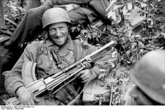 Fallschirmjäger (paratrooper) rests with a captured British Bren machine gun somewhere in Italy in 1943. Captured light arms were often used right away by the Germans given production delays and difficulties in resupply. This practice was especially pronounced in Russia, where huge amounts of Soviet armaments were routinely captured by the Germans.