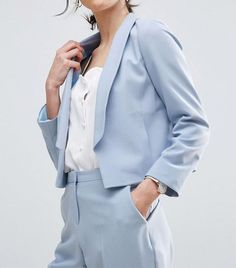 Add to your work wardrobe's color palette with colorful suits for women. Keep reading to see our top picks.