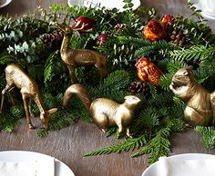 Set a Gorgeous Scene | One Kings Lane.  Could use plastic animals sprayed gold and rubbed with a bit of stain...