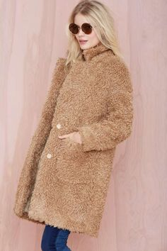 Get shaggy with it in this oversized camel coat.