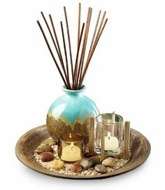 San Miguel Coreyna Reed Candle Garden by San Miguel. $29.99. Imported. Add a touch of natural beauty to your home with a creative display ofbeachwood, crushed shells, river stones, flickering candlelight and the fragrance of ocean mist. Includes 2 glass votive holders, 12 reeds measuring 11'', 3 fl oz. of ocean mist fragrance oil. 103/4'' x 12''.