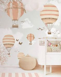 Gender neutral nursery ideas we love: Adventure-inspired decor. A sense of wonder comes standard with these wallpaper options.