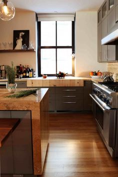 ~beautiful kitchen~Trim-less windows with dark frames and large panes...love.