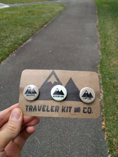 Introducing our Sticker/Button Pack!!! The pack includes: 1 Wander sticker, 1 Traveler Kit and Co. Sticker, and 3 buttons! The buttons are displayed on distressed chipboard with our inked on logo. Specs: Buttons are 1 Adventure button is glow in the dark Wander Sticker 4x3.25 Traveler Kit and Co. Sticker 4x 2.75 ---Stickers are Matte Die-cut decals perfect for any surface including windows.