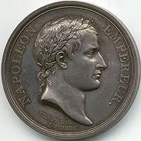 Front side of the medal was struck to commemorate the coronation of Napoleon I. Napoleon was portrayed in a Caesar like profile on the heads of the medal.The reverse design, drawn by Chaudet, illustrates the ancient Frankish custom of acknowledging a new chief by raising him on a shield. It also symbolizes the support of Napoleon by the people represented by a Roman senator and the military.