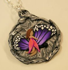 Polymerclay pendant with millefiori background and a fairy riding a butterfly - Polymerclay by KVJ