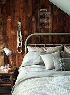 Bedroom: rustic wood panel wall with light furnishings
