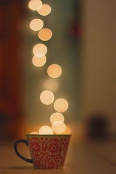 """A cup of hopes and dreams."" How cute with the reflection of lights lookin like it's coming from the mug!"