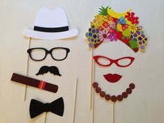 9 Piece Photo Booth Set includes: 2 Glasses 1 Lips 1 Mustache 1 Bow Tie 1 Necklace 2 hats 1 cigar * FREE gift with every order! *