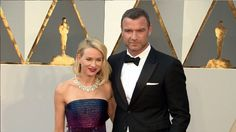 Naomi Watts and Liev Schreiber are loved up on the red carpet at 2016 Academy Awards. Liev looked dapper in a tux while Naomi stunned in a blue and purple bedazzled strapless dress.