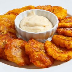 Nothing like tostones with a mojo (garlic) dipping sauce. Delicious side or snack w Caribbean or Latin food. Mmm. Just had some (without the sauce) with a Roti. Delsih I say!