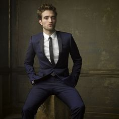 Robert Pattinson rocks blue and black (or is it white and gold?) for @markseliger #vfoscarparty