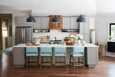This open concept kitchen shines with vaulted ceilings and an inviting color palette of blue, white and gray. Classic design mixes with rustic elegance for a room that's sure to please the whole family. Home Decor Kitchen, Kitchen And Bath, Kitchen Design, Kitchen Ideas, Open Kitchen, Kitchen Planning, Kitchen Colors, Kitchen Sink, Kitchen Cabinets