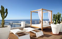 Relax in our new balinese bed with the stunning views overlooking the ocean and harbour of Puorto Rico!