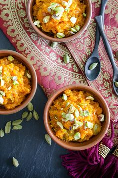 Recipe: Carrot Halwa — 1 pound carrots, peeled 2 tablespoons ghee or neutral cooking oil 8 green cardamom pods, seeds only, crushed 3 cups whole milk 1 1/4 cup sugar 1/4 cup raisins Pinch saffron threads 1/4 cup unsalted pistachio nuts, chopped