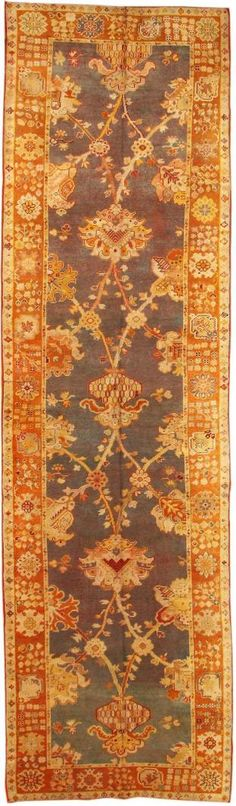 Antique Donegal Rug, Ireland, Late 19th Century - While antique Donegal carpets often reflect Medieval Irish and Art Nouveau styles, this magnificent example takes inspiration from classical Persian design, especially Kerman vase carpets